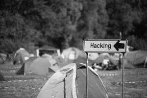Creative Commons hacking sign in field of tents by Alexandre Dulaunoy_Flickr