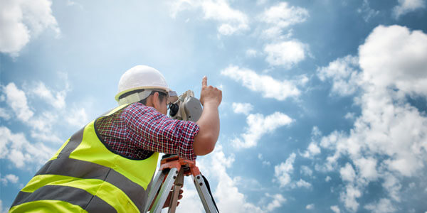 A hard hat can protect you against physical damage, but only surveyors' insurance offers professional protection.